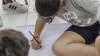 Young man drawing in October 2016, in Santa Catarina, Rugby Brazil Festival